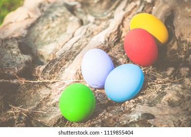 Colorful easter eggs on natural stone texture background