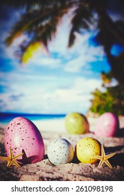 Colorful easter eggs on ocean beach â?? retro style