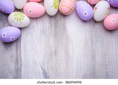 Colorful Easter eggs on old cracked wooden background. Copy space. Easter concept. Happy Easter !