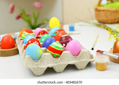 Colorful Easter eggs on white table closeup