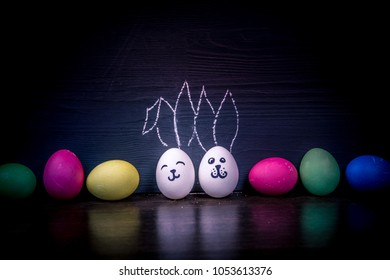 colorful easter eggs painted with rabbits ears on the background of the chalkboard. Copy Space