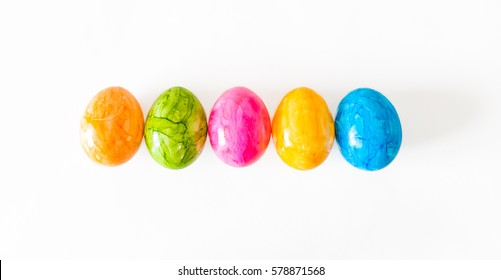 Colorful easter eggs in a row and white background