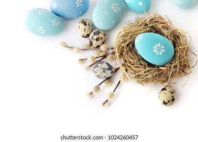 colorful easter eggs and spring flowers isolated on white background