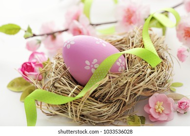 colorful easter eggs and spring flowers on white background