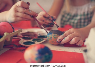 Colorful Easter Eggs star in this holiday series. Includes little girl coloring the eggs, as well as copy space images for backgrounds.
