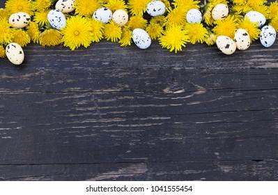Colorful Easter eggs upper edge over dark wooden background