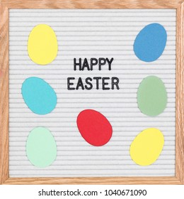 Colorful Easter. Letter board with paper Easter eggs saying Happy Easter.