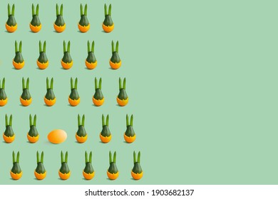 Colorful easter pattern of green avocado bunny in green and orange. Minimal background. Front view. Copy space
