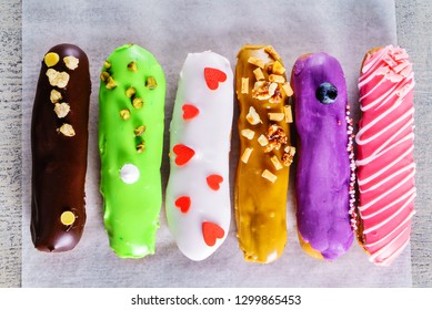 colorful eclairs with fruits