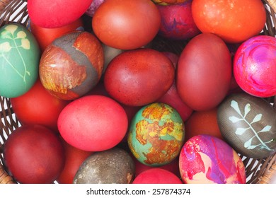 Colorful  Eggs in a Basket. Top View. Easter Background.
