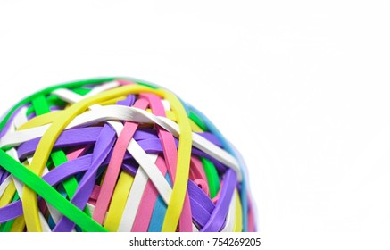 Colorful Elastic/Rubber Bands Collected into a Ball on a White Background