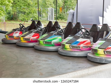 Colorful electric bumper cars in autodrom in the fairground attractions at amusement park.