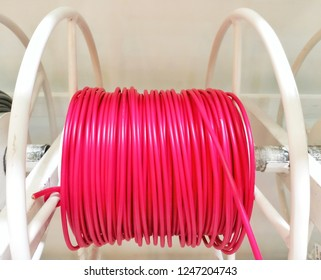 Colorful electric wire in the roll spin their made from Polyvinyl Chloride or PVC and Cross Linked Polyethylene or XLPE. Oversheath made from PVC PE and Low Smoke Halogen Free (LSHF).