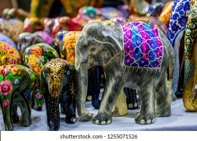 Colorful elefants in the souvenir shop in in Hauz Khas Village, a tourist attraction in Delhi, India.