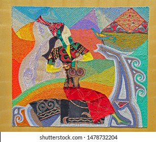 Colorful embroidery of Kazakh girl on horse playing kobyz (Asian string instrument)