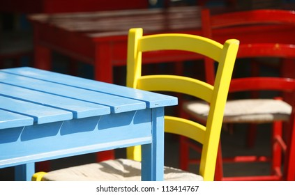 Colorful empty chairs and tables