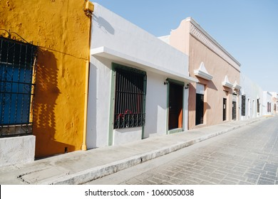 Colorful empty colonial street in the historic center of Campeche. Facade of a house with a colored wall