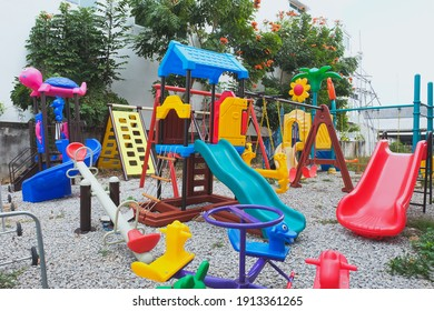 Colorful empty playground in summer scenery in garden.