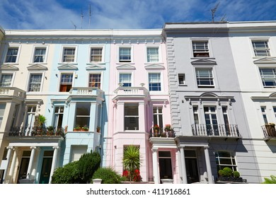 Colorful English houses facades in London, blue sky in a sunny day