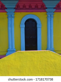 Colorful Entrance with Arched Door