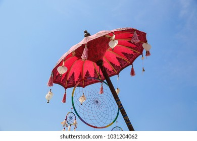 Colorful ethnic place, boho style decor. Outdoor or indoor decoration. Umbrellas with yellow orange and violet colors. Energy colors.