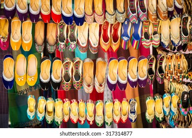 Colorful ethnic shoes on flea market in India