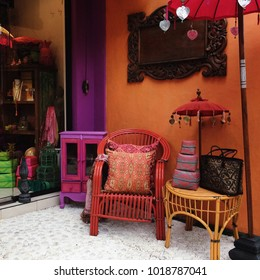 Colorful ethnic shop, boho style home decor. Facade with orange and violet colors. Energy colors.