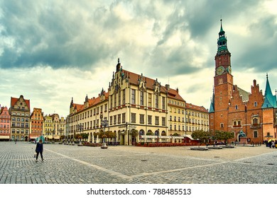 Colorful evening scene on Wroclaw Market Square with Town Hall. Sunset in historical capital of Silesia Poland, Europe. Artistic style post processed photo.