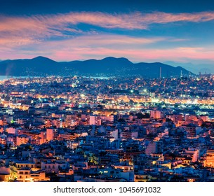 Colorful evening view of Athens, capital of Greece, Europe. Fantastic spring sunset in the big sity. Traveling concept background. Artistic style post processed photo.