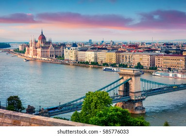 Colorful evening view of Parliament and Chain Bridge in Pest city. Splendid spring cityscape of Budapest, Hungary, Europe. Artistic style post processed photo.
