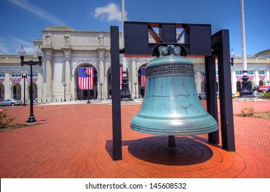 Colorful Exterior shot of Union Station and bell in Washington DC
