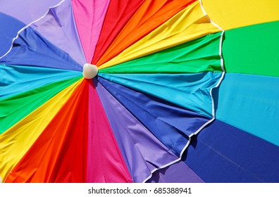 colorful fabric beach umbrella with rainbow design