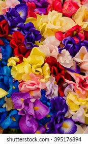Colorful fabric flowers background / fabric flowers background