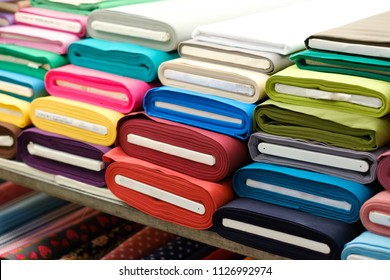 colorful fabric rolls on textile market
