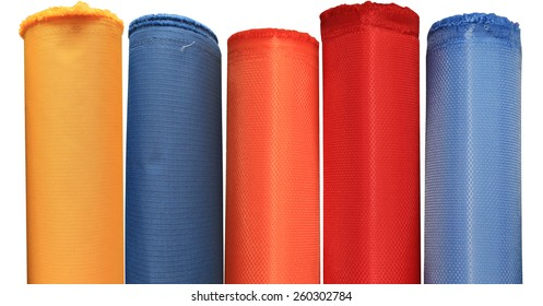 Colorful fabric rolls in warehouse - isolated on white background