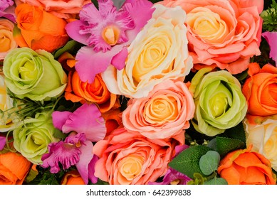 Colorful of fabric roses for background.
