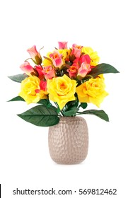 Colorful fabric roses in vase isolated on white background.