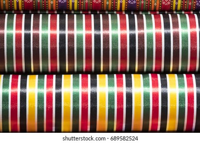 Colorful fabric scarves in stack as background