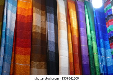 Colorful fabrics in the medina market of Marrakech,  Morocco, Africa