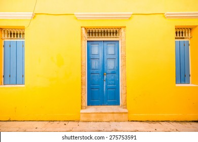Colorful facade with blue vintage windows and door