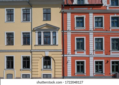 Colorful facade with yellow and red of historic buildings
