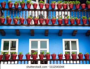 Colorful facades of Hondarribia (Spain) with balconies and flower pots. Architectural detail.