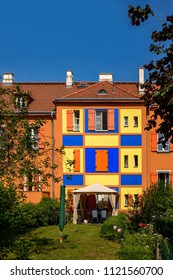"Colorful facades are typical for the Berlin ""Gartenstadt Falkenberg"" (""Falkenberg Garden City""). The listed settlement, built in the 1910s, is known as ""Tuschkastensiedlung"" (""Paint Box Estates"")"