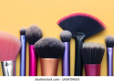 Colorful face and eyes make up brushes in a row