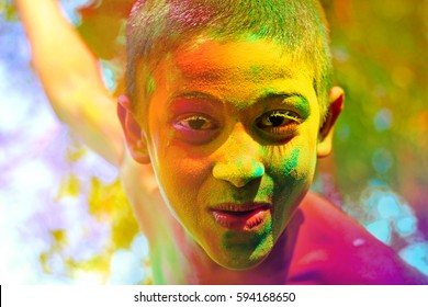 Colorful face of indian child in holi festival