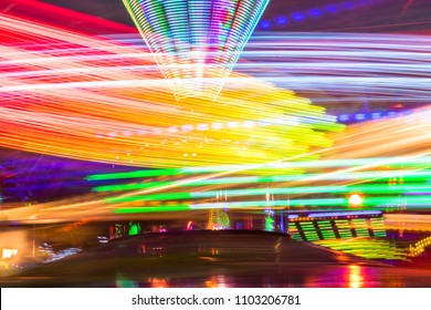 A colorful fairground ride with a long exposure