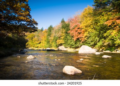 Colorful fall foliage on the bank of a small river