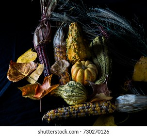 Colorful Fall gourds, leaves and corn