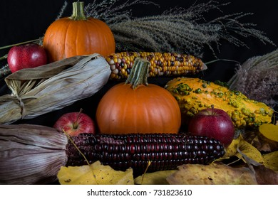 Colorful Fall pumpkins, corn, leaves and apples
