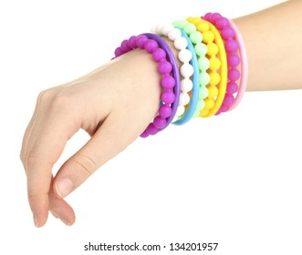 Colorful fashion bracelets on woman hand isolated on white